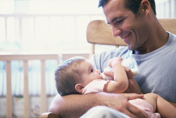 Father feeding his baby boy