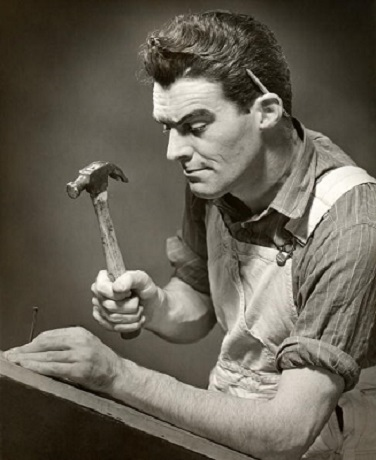 UNITED STATES - CIRCA 1950s:  Carpenter hammering a nail.  (Photo by George Marks/Retrofile/Getty Images)
