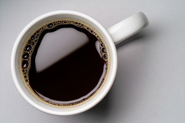 Coffee cup on grey background (seen from above)
